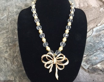 One of a kind Necklace with Crystal and Pearl Beads with Gold Spacers with Retro Rhinestone Bow Pendant