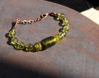 Round and round: peridot unisex bracelet and handmade glass