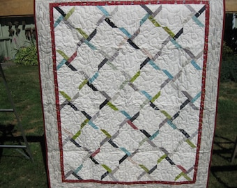 Twirling X's Throw size Quilt