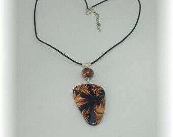 Pistils in fiery colors - pendant on black leather cord - C17PCE01
