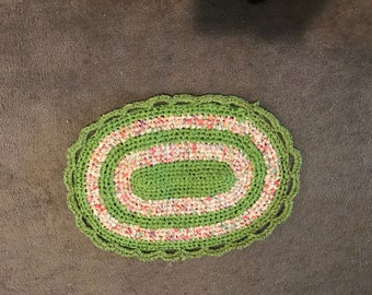 Small, oval, hand crocheted rag rug