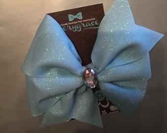 Jumbo Light blue glitter 6  inch bow on lined alligator clip with rhinestone center