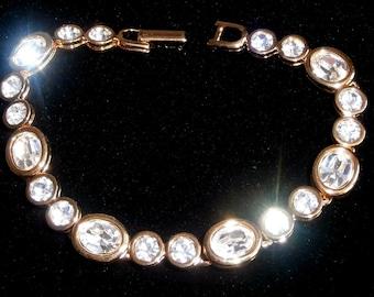 Swarovski Signed Bracelet Gold Plated with Bezel Set Crystals - Swan Logo - 26 grams