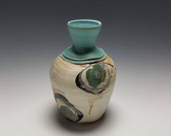 Handmade ceramic vase by Potteryi. Flower vase with green and black brushwork.
