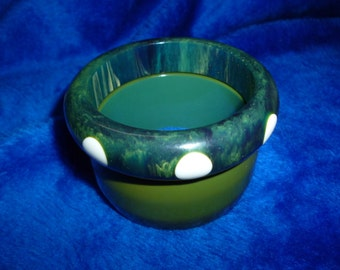 Pair of Bakelite bracelets green end of day with white poke a dots and solid green. a300