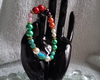 hand crafted ladies bracelet with faux pearl and lampwork bead detail