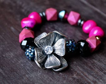 hot pink, navy pave bracelet with silver flower.