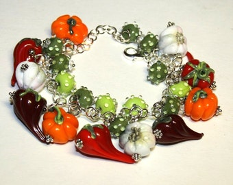 Handmade lampwork bracelet with murano glass hot peppers, garlic and pumpkins, glass bracelet, artisan glass bracelet, chain bracelet