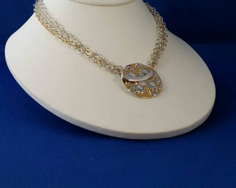 Vermeil & Silver Donut  Toggle focal piece on multi-strand Sterling and Gold-filled chains.  16 inches.