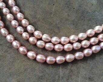 Full Strand Peachy Pink Freshwater Potato Rice Pearls, 8 – 10mm x 8mm