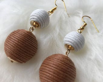Bobble earrings in brown and neutral