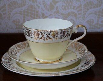 Pretty Vintage English Fine Bone China Trio Tea Cup Saucer Plate Yellow Gilded  In perfect condtiion