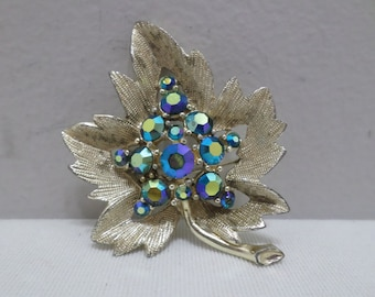 Vintage gold tone metal brooch or Pin with blue AB coated  rhinestones costume jewelry