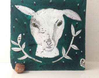Painting on reclaimed wood of a lamb