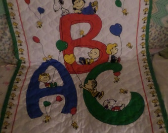 Vintage Snoopy Quilt wall hanging was a pattern on fabric that you sewed Baby Blanket Balloons green red blue