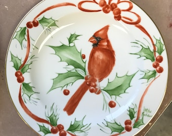 A pair of cardinal plates. One male one female. Handpainted on fine china. 10 1/2 inches .
