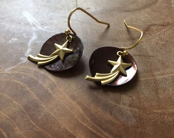 Shooting Star - Pair of limited edition dangling earrings with black mother of pearl and goldtone earhooks and shooting star charm.