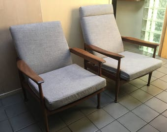 A Beautiful Pair of His and Hers Guy Rogers Manhattan 1960s reclining lounge chairs.