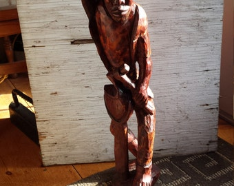 African Tribal Wood Carving of a Man Wielding a Hand Held Sledge Hammer