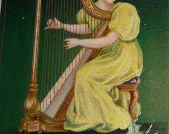 Pretty Lady Playing a Harp With Holly Antique Christmas Postcard