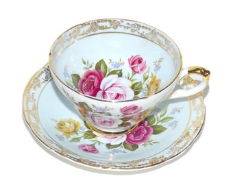 Vintage Royal Sutherland Tea Cup and Saucer Set Striking Rose Bouquet on Pale Blue