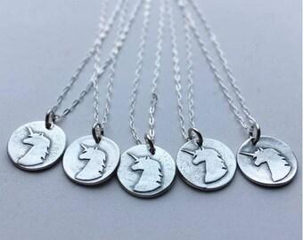 Silver unicorn pendant handmade by Lori Magno