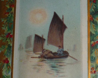 Scene With Sailboat Surrounded by Holly Antique Christmas Postcard