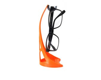 SpecStand is The Vertical Desktop Eyewear Holder! Space Saving Glasses Stand, Makes a Great Gift! Wide Selection of Colors Available!