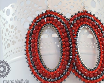 Hoop earrings with red and hematite seed beads.