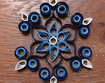 Handmade, blue and white, quilled, snowflake ornament, decoration.