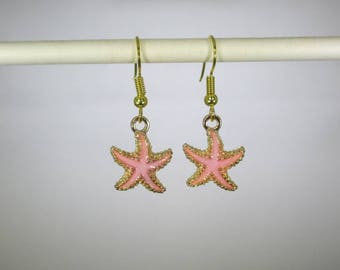 Gold finished salmon/pink starfish dangle earrings