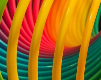 Rainbow Slinky! Abstract photography, nursery decor, red, green, yellow, blue, fine art photography, modern.