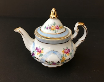 """Sweet Little Child's or Doll's Sized Porcelain Teapot with Roses and """"Ribbons"""""""