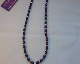 Purple wooden necklace with Celtic knot.
