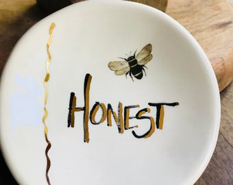 Bee Honest in gold On Handmade Ceramic Dish for Rings or Spoon Rest