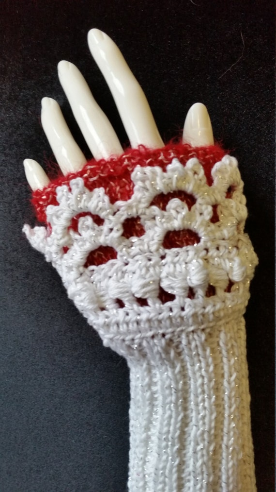 L405.  Hand knitted wristlets with crochet finish