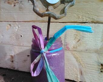 Tap flower in purple vase