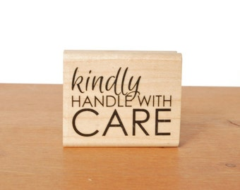 rubber stamp: kindly handle with care