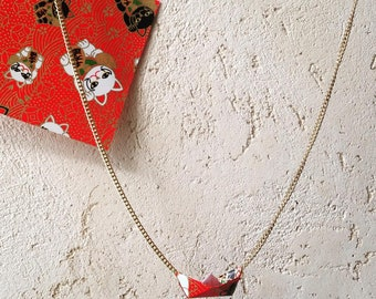 Handmade origami necklace with boat