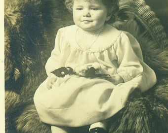 Little Girl Sitting on Fur Wicker Chair Toddler Antique RPPC Real Photo Postcard Vintage Black and White Photograph