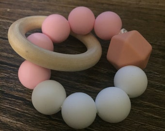 Silicone beads and wooden ring teething ring