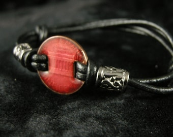 BRACELET, ENAMELED PENNY 6 to 8 1/2 in. Red Lead Free Enamel, Ajustable Leather Cord, Blackened Silver Rondels Accent Each Side of Penny