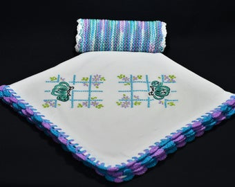 Hand embroidered dish towel with matching knitted dish cloth