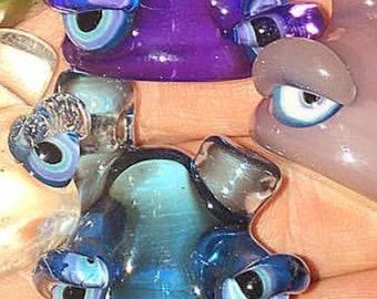 Purple and blue creature pendant
