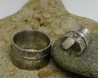A set of a ring and cuff earring
