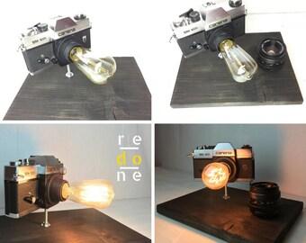 Carena Camera Lamp