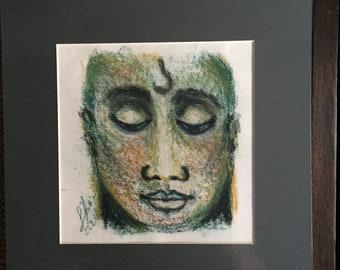 Reflective Buddha Face
