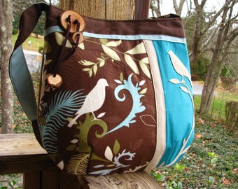 Bird Enchantment shoulder bag in blue and brown with adjustable strap and 6 pockets