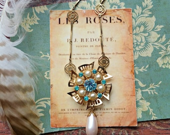 pinwheel. upcycled assemblage necklace, shabby chic, aqua blue rhinestones, pearl drop, altered jewelry, repurposed brooch, fab flea market