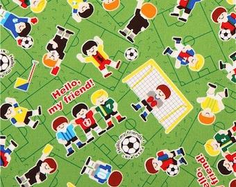 203063 cute green football player oxford fabric by Kokka